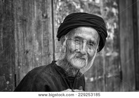 Dazhai, China - August 4 ,2012: Portrait Of An Old Chinese Man In The Village Of Dazhai In China, As