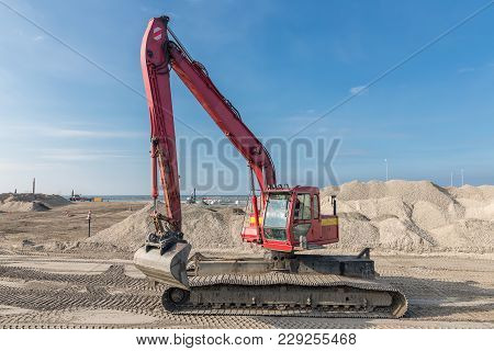 Excavator At Construction Site For Building A New Harbor Near Lelystad In The Netherlands