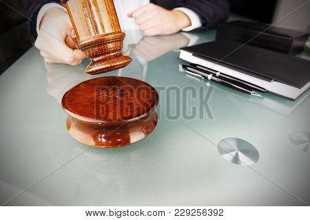 Auctioneer Prepared To Hit The Gavel In Order To Decide The Auction Winner