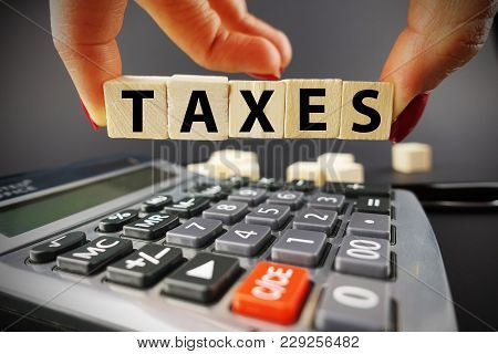 Time For Tax Computation, Accounting Services Concept With Businessperson With Wooden Cubes Above Ca