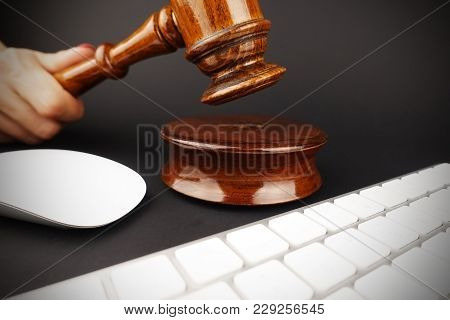 Woman Hand Holding Auctioneer Gavel Near Keyboard And Computer Mouse, Online Auction Concept