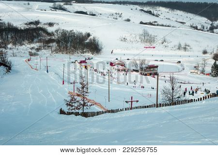 Poltava, Ukraine - March 02, 2018: People Descend On The Ski Slope Near Poltava
