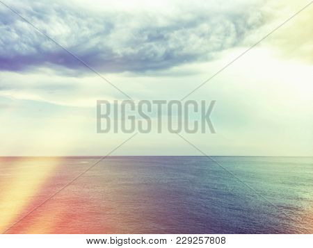 Retro Style Image Of Sea And Clouds. Light Leaks Effect.