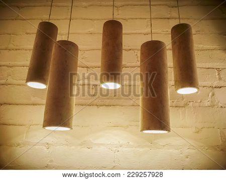 Concrete Industrial Design Pendant Lamps. Image In Sepia Tones, With Vignette.