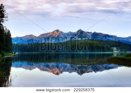 Sunset At Two Jack Lake In Banff National Park With Sunlit Mount Inglismaldie And Mount Girouard In