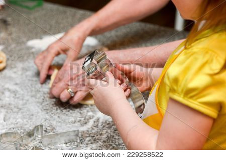 Little Girl Baking Cookies With Great Grandma