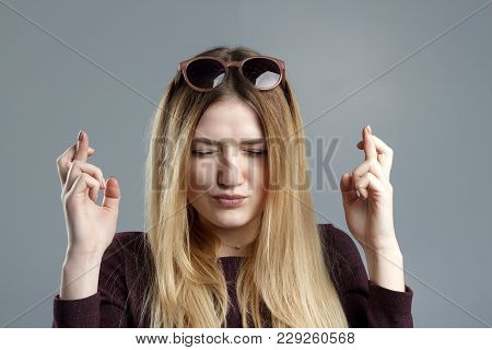 Closeup Portrait Hopeful Beautiful Woman Crossing Her Fingers, Eyes Closed, Hoping, Asking Best Isol