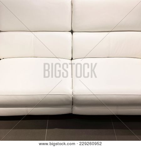Empty Luxurious White Leather Sofa. Classy Furniture.