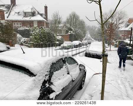 HAMPSTEAD, LONDON - FEBRUARY 28, 2018: Snow covered cars and roads in the suburban streets of Hampstead, North London, UK.
