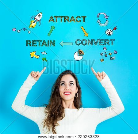Attract, Convert, Retain With Young Woman Reaching And Looking Upwards