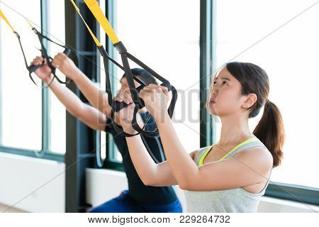 Charming Beauty Asian Girl Learning Hard Workout With Total Body Resistance Exercise Trx For Trainin