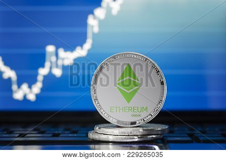 Ethereum Classic (etc) Cryptocurrency; Silver Ethereum Classic Coin On The Background Of The Chart