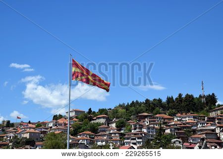 Macedonian Flag With Ohrid Town And Tsar Samuel Fortress Background. Ohrid, Macedonia