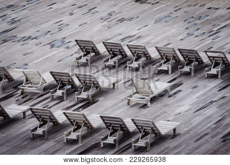 Beach Lounge Deck Chairs. Relax And Enjoy Travel Destination With Leisure And Relaxation In Wooden D
