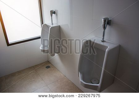 Urinals For Men In The Toilet Office Building.