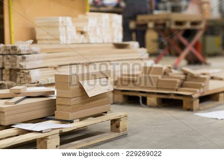 production, manufacture and woodworking industry concept - wooden or mdf boards at workshop