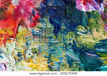 fine art, creativity and concept - close up of palette with colorful paint strokes