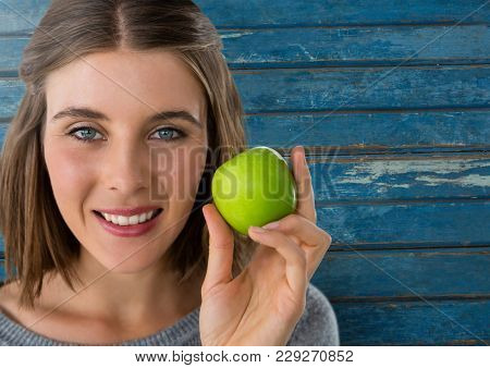 Digital composite of Woman against wood with apple