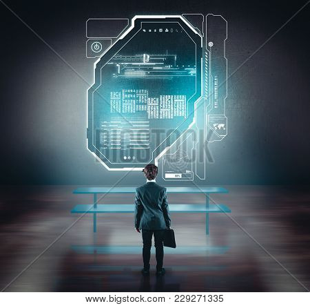 Businessman Working Of A Wall With A Toch Screen. The Concept Of Working On A Network