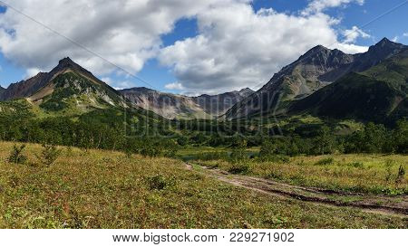 Scenery Panoramic Mountain Landscape Of Kamchatka Peninsula: Early Autumn View Of Mountain Range Vac