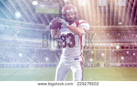 one quarterback american football player throwing ball on big modern stadium field with lights and flares