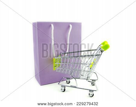 Purple Paper Bag With Shopping Trolley Isolated White Background