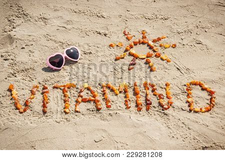 Sunglasses, Inscription Vitamin D And Shape Of Sun Made Of Amber Stones At Beach, Concept Of Vacatio