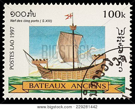 Moscow, Russia - March 03, 2018: A Stamp Printed In Laos Shows Ancient (13th-century) Sailing Ship,
