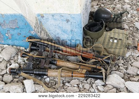 Rpg-7 Grenade Launchers On The Rocks In The Destroyed Building