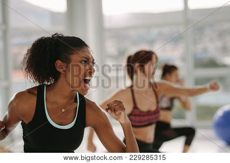 Group Of People In Gym Class Having Punch Training