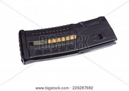 Airsoft Gun Magazine On White Background. High Resolution Photo.