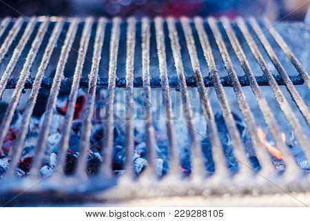 Metal Grill For Grilling On The Charcoal Grill In The Open Air.