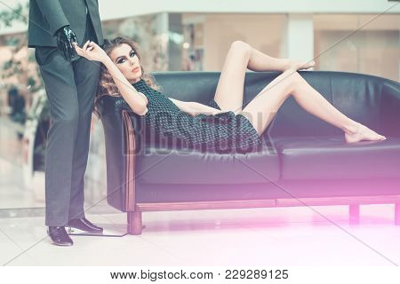 Girl Shopaholic Tired Shopping. Woman Shopper Relax On Sofa With Fashion Mannequin In Shop. Shop, Sh