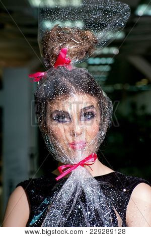 Pack, Package, Holiday Celebration, Preparation. Woman Face Makeup Wrapped In Overwrap, Pack. Girl W