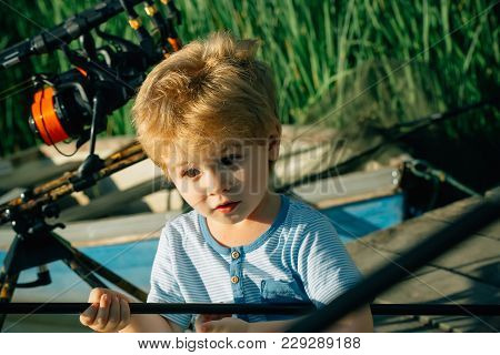 Small Child With Surprised Face Angling On River. Boy With Rod On Fishing Pier. Summer Vacation, Hob