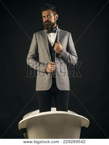 High Quality Sanitary Ware Concept. Guy With Strict Face In Suit Stands In Bathtub. Hipster With Sty