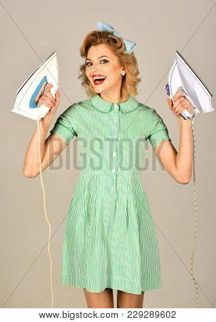 Funny Pin-up Cleaning Woman Having Fun With Red Lips Make-up Holding Steaming Hot Clothing Iron