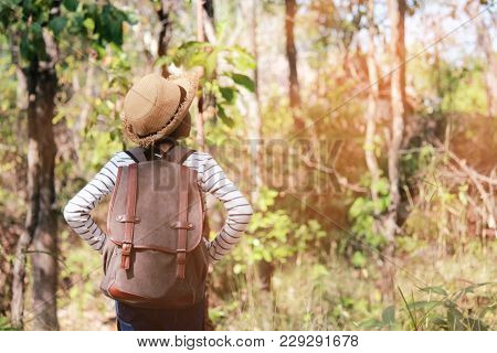 Traveler Young Girl With Backpack Walking On Path In The Tropical Forest, Relax Time On Holiday Conc