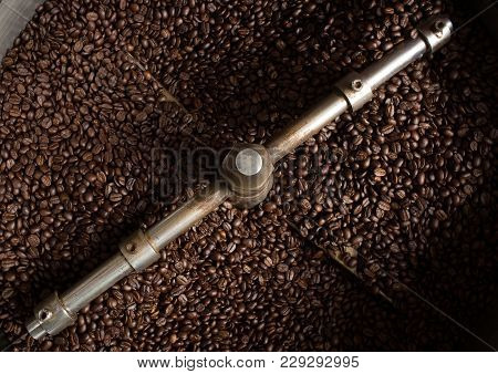 Roasting Process Of Coffee. The Freshly Roasted Coffee Beans In The Cooling Cylinder From Top View
