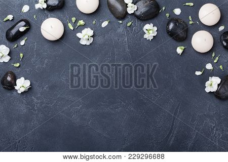 Aromatherapy And Spa Composition Decorated Flowers On Black Stone Background Top View. Beauty Treatm