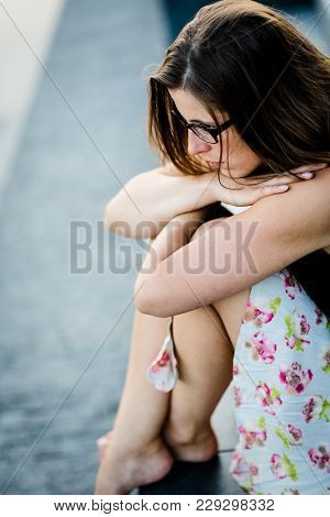 Barefoot Worried Woman Sitting With Legs Crossed