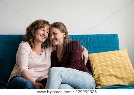Mature Mother Hugging Her Affectionate Teen Daughter