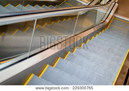 Reflection Pattern Of  Electric Escalator In Metro. Moving Up Staircase .close Up Floor Platform. Ye