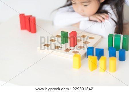 Little Girl Play With Blocks. Educational Toys For Preschool And Kindergarten Child. Little Girl Bui