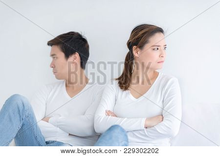 Young Couple In Bed Having Problem And Unhappy. People With Relationship Difficulties Conflict And F