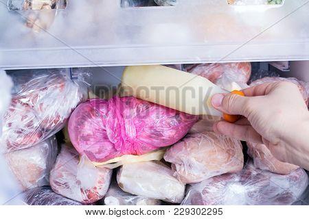 Refrigerator With Frozen Food. Frozen Milk. Open Fridge Freezer