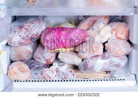 Refrigerator With Frozen Food. Open Fridge Freezer (meat, Vegetables).