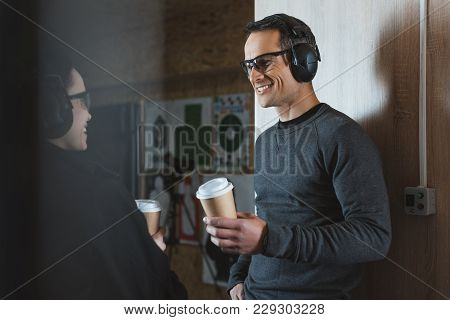 Smiling Customer And Shooting Instructor Drinking Coffee In Shooting Range