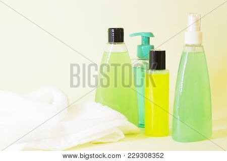Natural Cosmetics Concept. A Set Of Citrus Spa Cosmetic Products With Clean White Towel, Light Backg