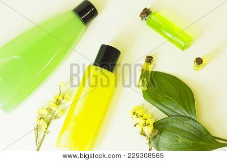Natural Cosmetics Concept. A Set Of Citrus Spa Cosmetic Products With Fruit Essential Oil In Glass B